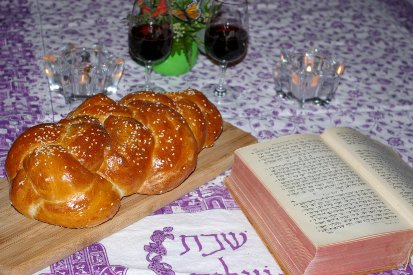 Shabbat Table with Challah, Torah, Candles and Wine